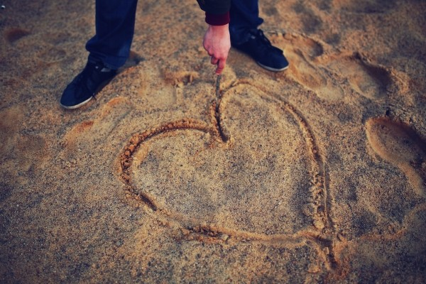 hand-drawing-heart-in-the-sand.jpg
